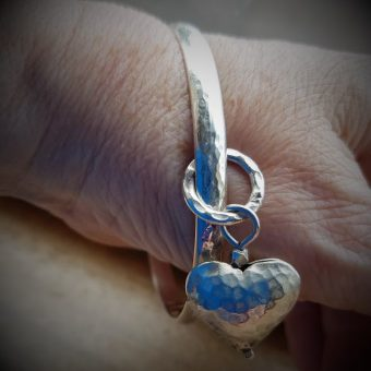 Chunky D Bangle with large puffed heart on Pamela. Quite a statement piece.