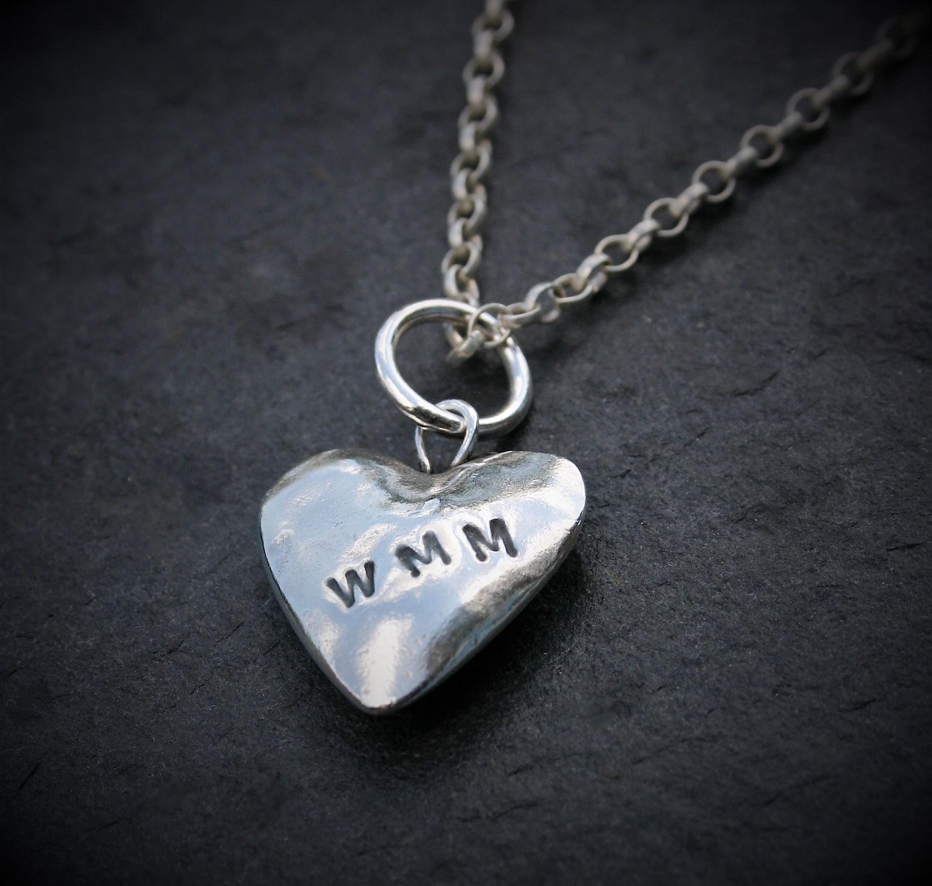 puffed silver heart